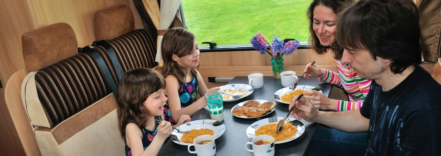 Family Eating In Motorhome